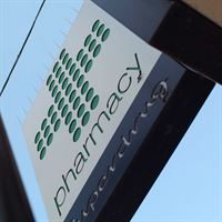 Defender 4™ Narrow Plastic Pigeon Spikes - Installed on Sign